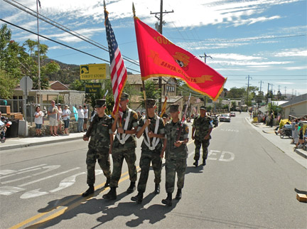 The Young Marines of Santa Clarita Valley present colors for the 45th Annual Fiesta Days Parade Saturday, Aug. 2...at the 46th Annual Fiesta Days marathon party and reunion. that continues through Sunday.. [photo by Patric Hedlund]