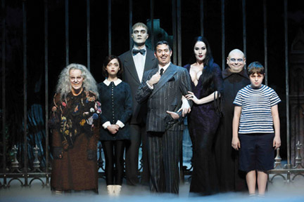 (l-r), Grandma, Wednesday, Lurch, Gomez (Jesse Easely aka Jesse Sharp), Morticia, Uncle Fester and Pugsley are beckoning. [Addams Family photo]