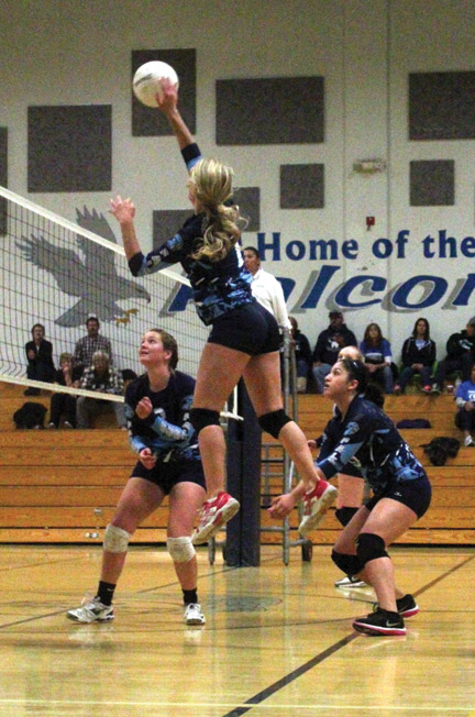 Falcon player Rachel Rivette dominated from the air. [photo by Cliff Coleman]