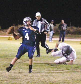 Quarterback Thomas Nierhoff, (4) saw hot action in the 36-29 pre-league victory. [photo by Cliff Coleman]
