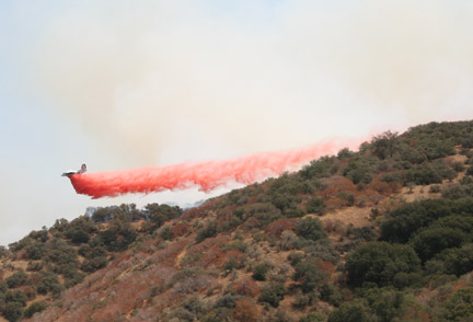 Rachelle Black caught this air-tanker dropping retardant near her home in Digier Canyon on Friday, July 19.