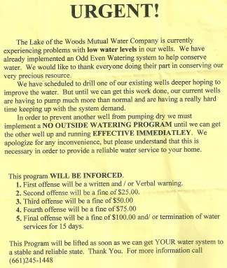 Lake of the Woods Mutual Water Company's notice of water restriction.